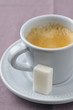 cup of expresso and a white sugar lump