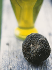 black truffle and bottle of olive oil