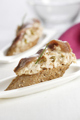 tuna,anchovy and capers on a bite-size slice of bread