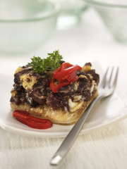 blood sausage,onion,egg and red pepper canapé