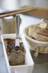 farmhouse paté,baguette and a jar of gherkins