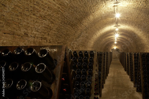racks of wine bottles in a cellar