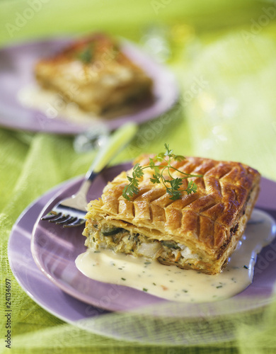 cod and vegetable flaky pastry pie with chive sauce