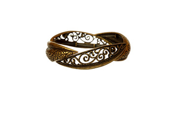 golden metal bracelet with a beautiful carving isolated on white