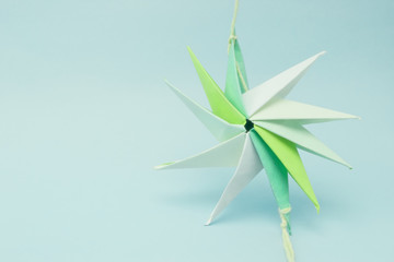 star shaped paper origami tied by a thread at ends