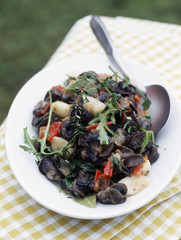 snail fricassée with garlic,tomatoes and rocket
