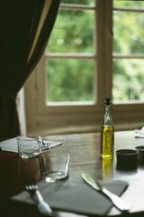 bottle of olive oil on a table inside