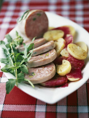 pistachio saucisson from lyon with potatoes and beetroot dressing