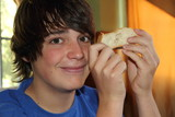 Young guy with a slice of bread