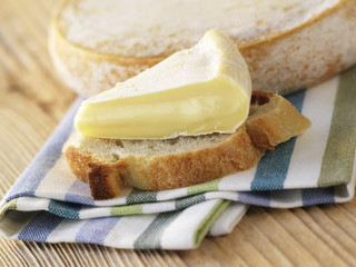 a piece of reblochon on a slice of bread