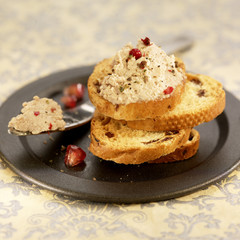 foie gras and pomegranate seeds on toast