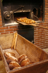 bringing bread loaves out of the oven