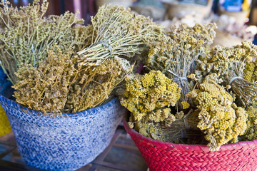 baskets of dried herbs in marrakech