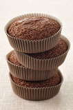pile of chocolate cup cakes