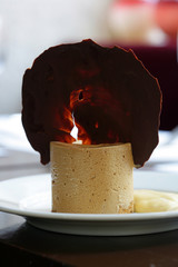 almond-flavored mousse and chocolate tuile biscuit