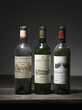 three  bottles of red bordeaux wine