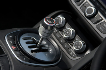 chrome 6-speed gear shift in luxury car