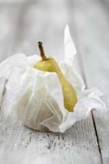 pear wrapped in silk paper