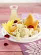 melon and mango fruit salad with vanilla ice cream