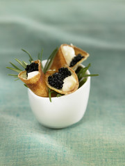 small cones filled with caviar and mahon cheese