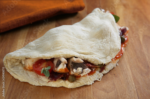 tomato,mushroom and caper calzone pizza