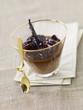chocolate cream dessert with stewed quetsch plums