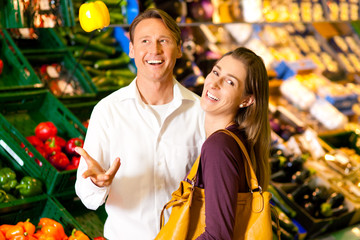 People in supermarket shopping groceries