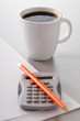cup of coffee,calculator and pencil