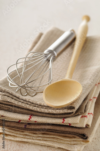 tea cloths,wooden spoon and whisk