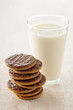 chocolate cookies and a glass of milk