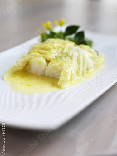 piece of cod with butter sauce