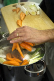 cooking the vegetables for the court-bouillon