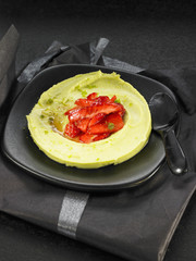 avocado mousse with strawberries and agave syrup