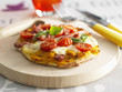 small pumpkin,tomato and mozzarella pizza