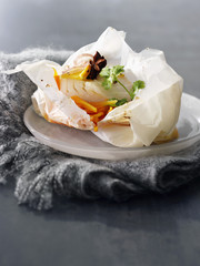 cod and carrots cooked in wax paper