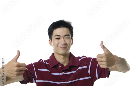 Casual man smiling doing thumbs up sign