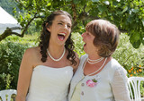 Bride and Mother enjoying a moment together laughing