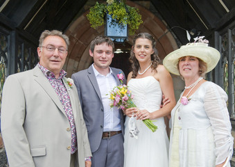 Bride and Groom with her Parents at Church Door