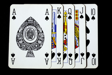 Poker Playing Cards on Black Background