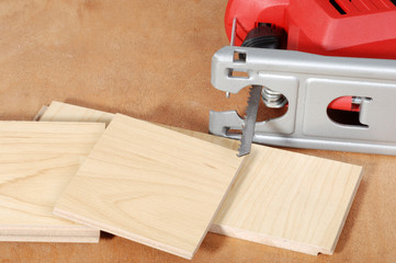 jigsaw with cut wood flooring