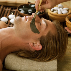 Spa.Handsome Man with a Mud Mask on his Face