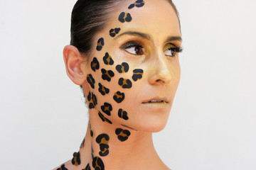 Woman with animal print make-up.