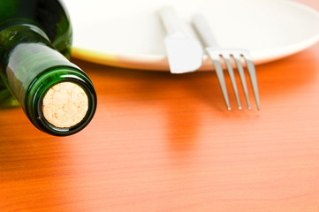 Bottle of wine on the wooden table