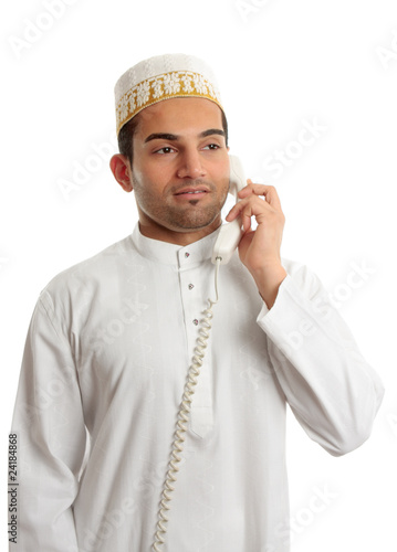 Arab man wearing white robe and topi