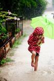 Fototapety Little girl walking in the rain