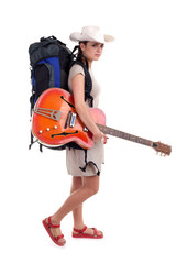 lady tourist with backpack and electric guitar