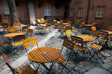 Lot of chairs in a cafe at the old prison in Breslau