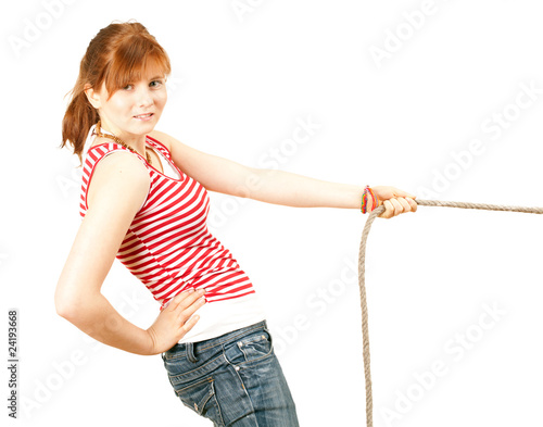 young woman pulling grey rope, tug-of-war