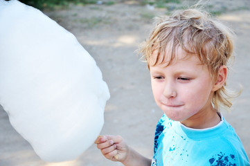 boy holding cotton candy