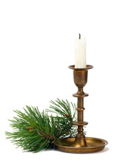 Candlestick with candle and pine branch on white background